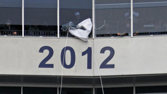 The year 2012 is unveiled on the facade of the private boxes at Beaver Stadium honoring the hardships faced by Penn State's 2012 football team during a senior recognition ceremony before an NCAA college football game against Wisconsin in State College, Pa., Saturday, Nov. 24, 2012. (AP Photo/Gene J. Puskar)