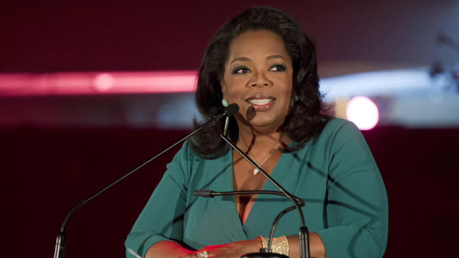 """FILE - In this March 9, 2012 file photo, Oprah Winfrey accepts her DVF Lifetime Leadership Award at The Third Annual DVF Awards held at the United Nations in New York. """"Oprah's Book Club 2.0,"""" a joint project of Winfrey's OWN network and her """"O"""" magazine, begins Monday with Cheryl Strayed's popular memoir """"Wild."""" Along with the traditional paper version of the book, special e-editions will be made available that include Winfrey's comments and a reader's guide.  (AP Photo/Charles Sykes, File)"""