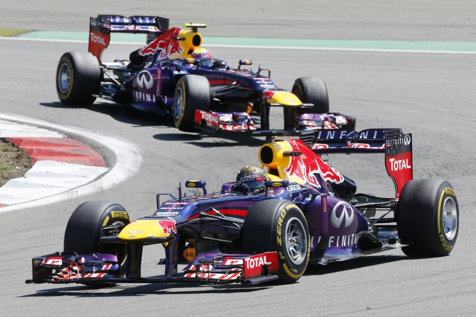 Red Bull driver Sebastian Vettel of Germany leads team mate Mark Webber of Australia during the German Formula One Grand Prix at the Nuerburgring racetrack, in Nuerburg, Germany, Sunday, July 7, 2013. (AP Photo/Michael Probst)