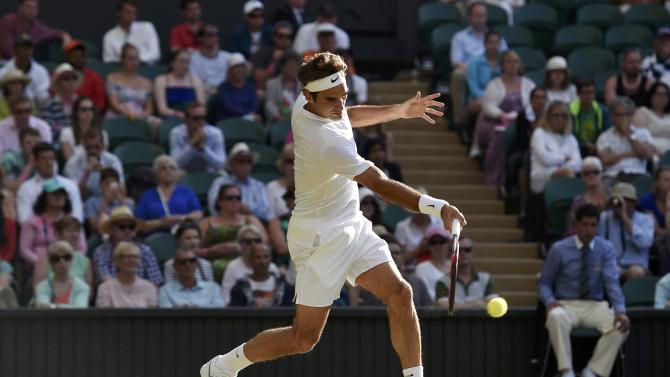 Roger Federer of Switzerland hits a shot during his match against Roberto Bautista Agut of Spain at the Wimbledon Tennis Championships in London
