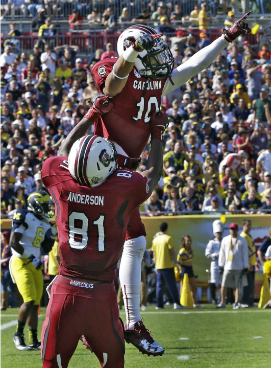 South Carolina wide receiver Damiere Byrd (10) celebrates with tight end Rory Anderson (81) after scoring on a 56-yard first-quarter touchdown against Michigan during the Outback Bowl NCAA college foo