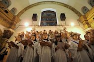"<p>Chinese worshippers sing hymns during the Christmas Eve mass at a Catholic church in Beijing on December 25, 2012. Pope Benedict XVI on Tuesday called for an ""end to the bloodshed"" in conflict-wracked Syria in a traditional Christmas message that touched on several other of the world's conflict zones.</p>"