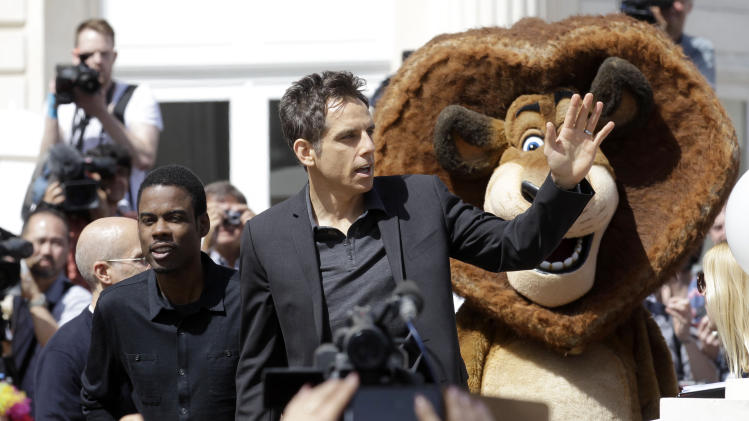 Actors Chris Rock, left and Ben Stiller wave to fans during a photo call for Madagascar 3 during the 65th international film festival, in Cannes, southern France, Thursday, May 17, 2012. (AP Photo/Lionel Cironneau)