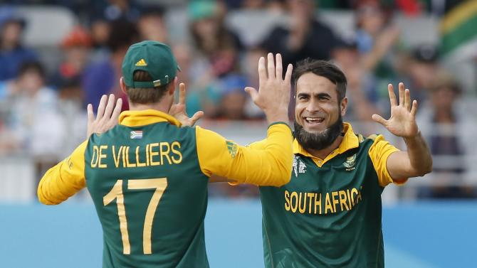 South Africa's Imran Tahir celebrates with teammate AB de Villiers dismissing Pakistan's Wahab Riaz during their Cricket World Cup match in Auckland