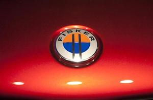 The Fisker automotive electric Atlantic sedan logo is seen during its unveiling ahead of the 2012 International Auto Show in New York