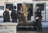 Mohammad Shafia, center, Tooba Yahya, right, and Hamed Shafia, left, arrive at the Frontenac County courthouse in Kingston, Ontario, Sunday, Jan. 29, 2012. A jury took 15 hours to find each guilty of four counts of first-degree murder in a case so shocking it has riveted Canadians from coast to coast. (AP Photo/The Canadian Press, Graham Hughes)