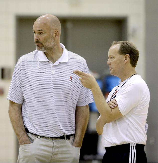 Atlanta Hawks head coach Mike Budenholzer, right, talks to general manager Danny Ferry during NBA basketball training camp, Tuesday, Oct. 1, 2013, in Athens, Ga