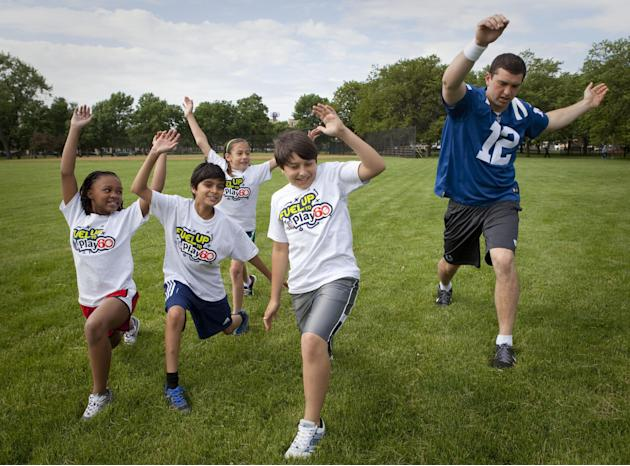 IMAGE DISTRIBUTED FOR QUAKER OATS - In this image released on Tuesday, October 29, 2013, NFL Quarterback and Quaker spokesperson Andrew Luck gets moving with kids during a video shoot to help spread t