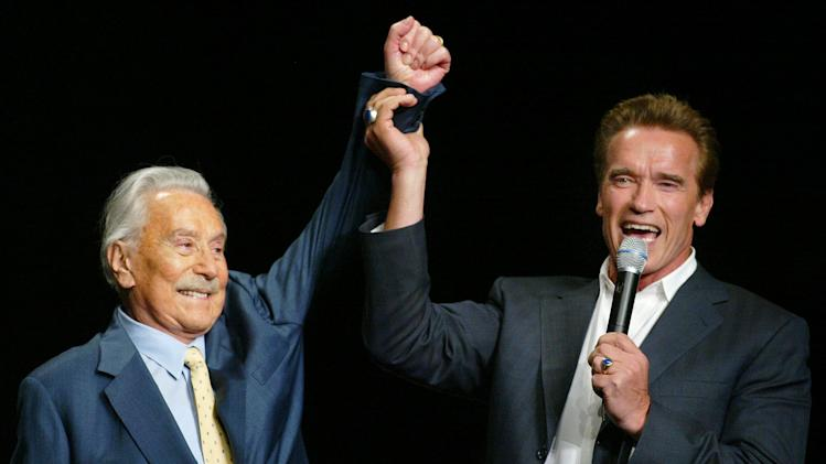 FILE - This Oct. 25, 2003 file photo shows then California Gov. Arnold Schwarzenegger, right, raising the arm of Joe Weider, the creator of Mr. Olympia Bodybuilding competition, during the 39th annual Mr. Olympia event in Las Vegas. Weider, the legendary bodybuilding impresario Arnold Schwarzenegger has often cited as his key mentor, died Friday, March 22, 2013, at age 93.(AP Photo/Eric Jamison, File)