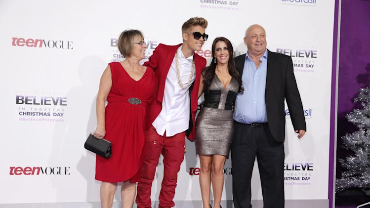 "Diane Dale, Justin Bieber, Pattie Mallette and Bruce Dale seen at the World Premiere of Open Road's ""Justin Bieber's Believe"" presented by Teen Vogue and sponsored by Clearasil, on Wednesday, Dec. 18, 2013 in Los Angeles. (Photo by Eric Charbonneau/Invision for Open Road Films/AP Images)"