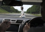 """A Toyota car stops automatically before a dummy, during a pre-collision system test in the demonstration of its safety technologies in Susono near Mount Fuji, west of Tokyo, Japan, Thursday, July 21, 2011. In the new system, Toyota uses cameras and a super sensitive radar called """"millimeter-wave,"""" both installed in the front of the vehicle, to detect possible crashes such as a pedestrian crossing the road.  (AP Photo/Koji Sasahara)"""