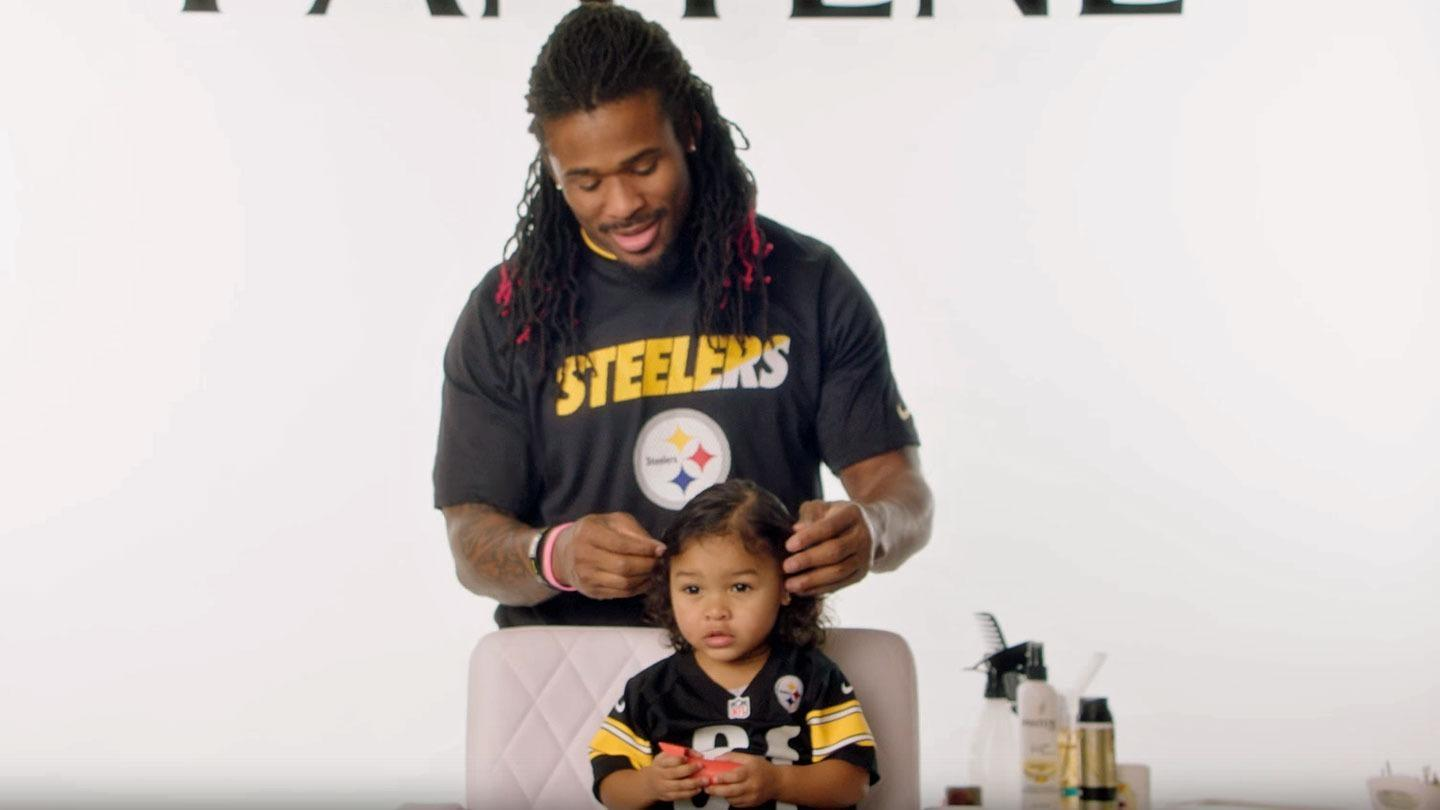 NFL players doing their daughters' hair is today's dose of adorable