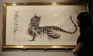 A painting entitled 'Tiger' by Qi Baishi pictured at an auction house in Hong Kong in 2010. Figures for Chinese art are sharply down at the major auctions this year