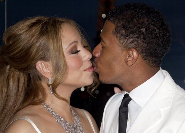 Musician Mariah Carey and husband Nick Cannon attend a photo call near the Eiffel Tower before their vow renewal ceremony in Paris
