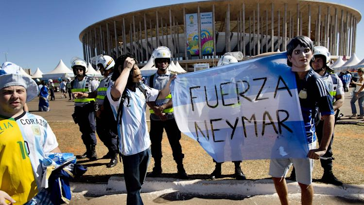 "Fans of Argentina's national soccer team hold a banner with a message that reads in Spanish; ""Strength Neymar,"" as they wait to enter the Estadio Nacional for the World Cup quarterfinal match between Argentina and Belgium, in Brasilia, Brazil Saturday, July 5, 2014. Neymar, the biggest football star in Brazil, was ruled out of the rest of the tournament after fracturing his third vertebra during Friday's 2-1 quarterfinal win over Colombia"