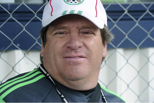 Mexico's soccer coach Miguel Herrera watches his players train for their upcoming World Cup qualifying match against New Zealand, at Dave Farrington Park, in Wellington, New Zealand, Sunday, Nov. 17,