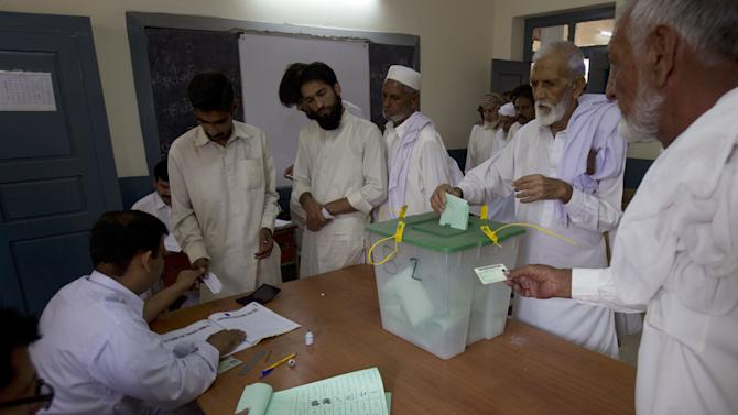 A Pakistani voter casts his ballot at a polling station in Islamabad, Pakistan on Saturday, May 11, 2013. Despite a bloody campaign marred by Taliban attacks, Pakistan was holding historic elections Saturday pitting a former cricket star against a two-time prime minister once exiled by the army and an incumbent blamed for power blackouts and inflation. (AP Photo/B.K. Bangash)