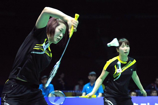 Kim Min-Jung (R) and Ha Jung-Eun (L) of South Korea compete against Mizuki Fujii and Reika Kakiiwa of Japan during their semi-final match at the Uber Cup world badminton team championships in China's