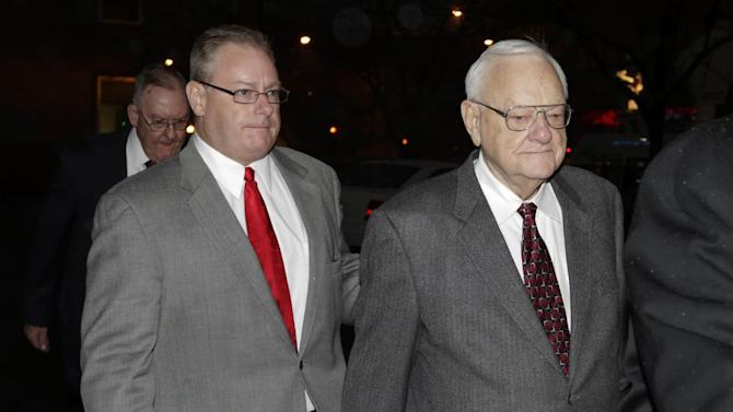 Former Illinois Gov. George Ryan, center,is accompanied with his son George H. Ryan Jr., left,  as he arrives at a halfway house in Chicago Wednesday, Jan. 30, 2013, after serving five-plus years in federal prison on corruption charges. The 78-year-old Ryan began serving his 6 1/2-year sentence in November 2007 in Oxford, Wis., and was released from another prison in Terra Haute, Ind., to enter the halfway house under a work-release program. (AP Photo/M. Spencer Green)