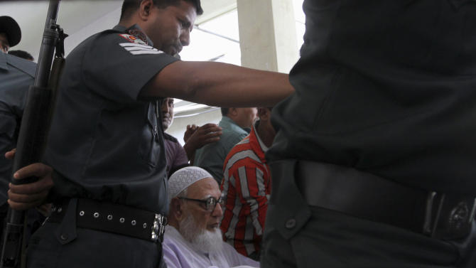 Bangladesh's Islamic party Jamaat-e-Islami former chief Ghulam Azam, center on wheelchair, is escorted by security people to a court in Dhaka, Bangladesh, Monday, July 15, 2013. The 91-year-old former chief of the Islamic party in Bangladesh was sentenced to 90 years in jail on Monday for crimes against humanity during the country's 1971 independence war, angering both supporters who said the trial was politically motivated and opponents who said he should be executed. (AP Photo)