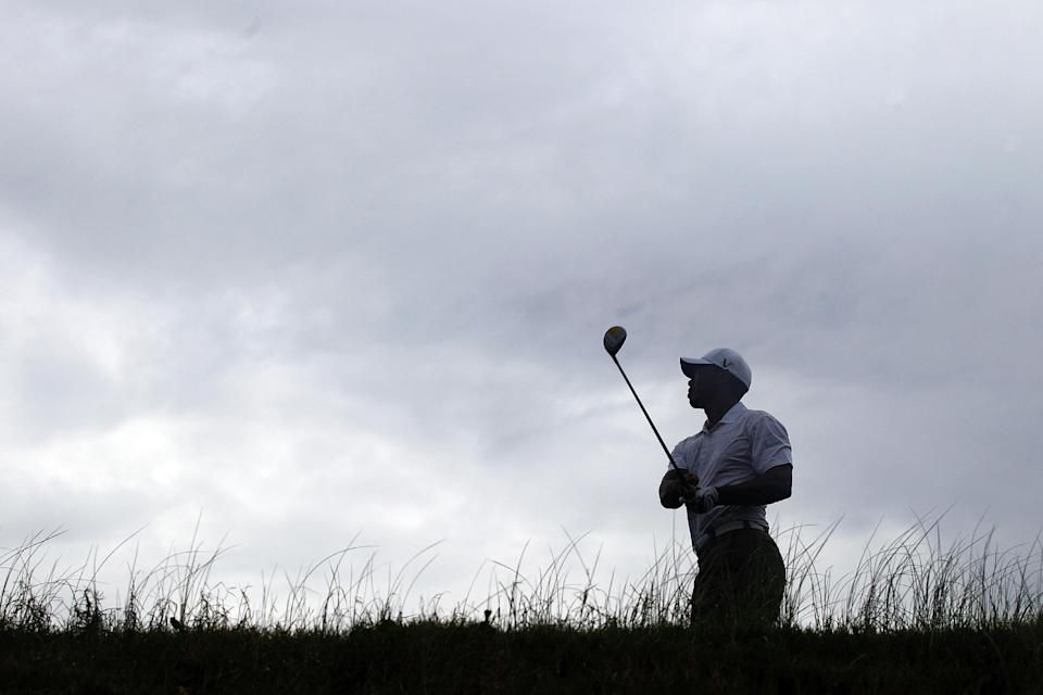 Tiger Woods watches his drive from the 12th tee during a practice round for the PGA Championship golf tournament on the Ocean Course of the Kiawah Island Golf Resort in Kiawah Island, S.C., Wednesday, Aug. 8, 2012. (AP Photo/Chuck Burton).(AP Photo/Chuck Burton)