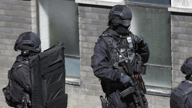 London Metropolitan Police take part in a mock terror attack at a disused underground station in central London
