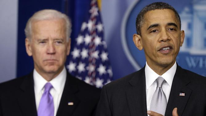 President Barack Obama stands with Vice President Joe Biden as he makes a statement Wednesday, Dec. 19, 2012, in the Brady Press Briefing Room at the White House in Washington, about policies he will pursue following the massacre at Sandy Hook Elementary School in Newtown, Ct. Obama is tasking Vice President Joe Biden, a longtime gun control advocate, with spearheading the effort. (AP Photo/Charles Dharapak)