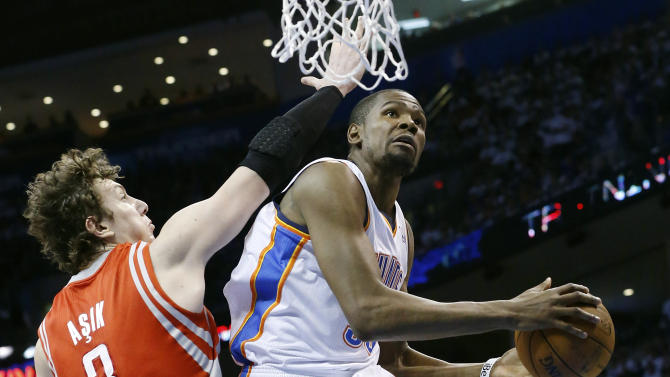 Oklahoma City Thunder forward Kevin Durant (35) shoots in front of Houston Rockets center Omer Asik in the third quarter of Game 2 in their first-round NBA basketball playoff series in Oklahoma City, Wednesday, April 24, 2013. Oklahoma City won 105-102. (AP Photo/Sue Ogrocki)