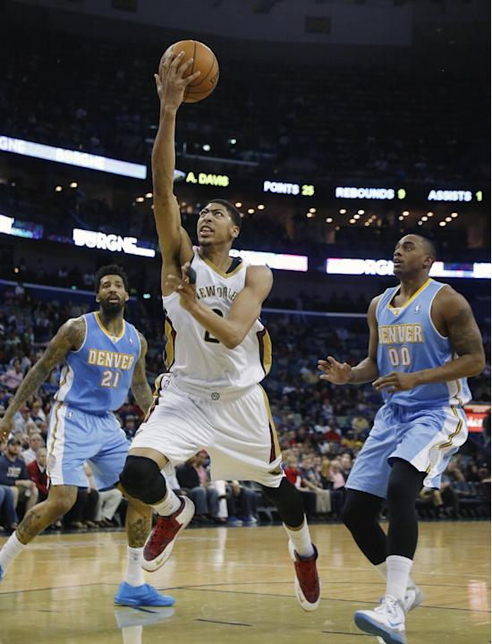 New Orleans Pelicans power forward Anthony Davis (23) goes to the basket in overtime in an NBA basketball game in New Orleans, Sunday, March 9, 2014. The Pelicans defeated the Nuggets 111-107. Looking