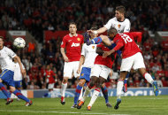 Manchester United's Ashley Young, right, scores a goal against FC Basel during their Champions League group C soccer match at Old Trafford, Manchester, England, Tuesday Sept. 27, 2011. (AP Photo/Jon Super)