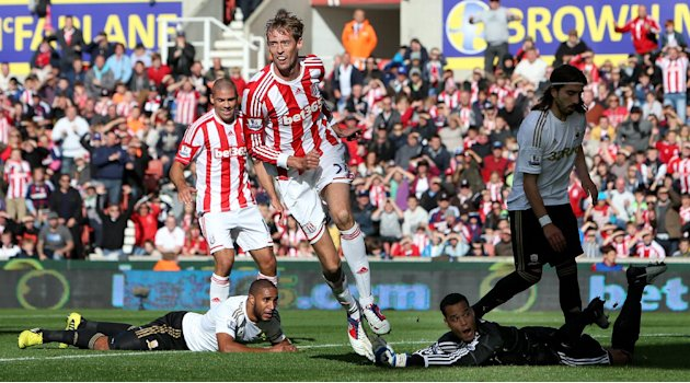 Peter Crouch, centre, scored Stoke's second goal