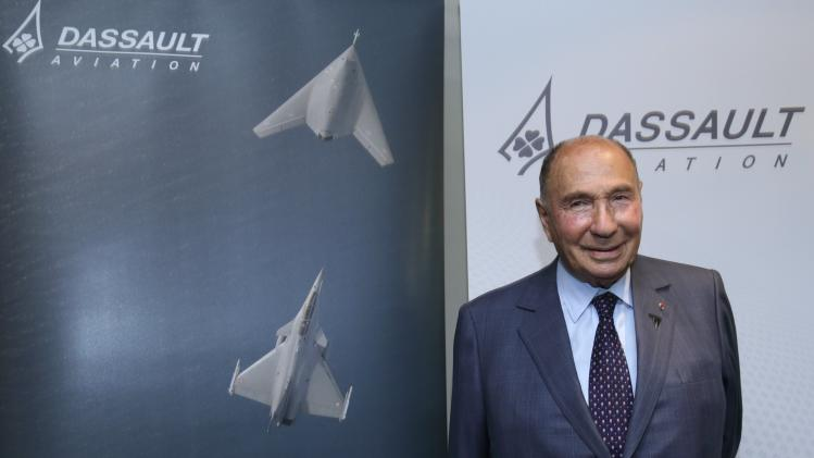 Serge Dassault, French UMP political party member and CEO of Groupe Dassault Holding, poses after Dassault Aviation's 2014 First-Half results presentation in Saint Cloud near Paris
