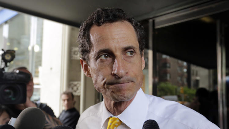 New York City mayoral candidate Anthony Weiner leaves his apartment building in New York on Wednesday, July 24, 2013. The former congressman acknowledged sending explicit text messages to a woman as recently as last summer, more than a year after sexting revelations destroyed his congressional career. (AP Photo/Richard Drew)