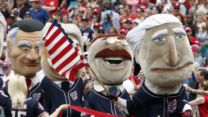 "A mascot of President George Washington leads the ""Racing Presidents,"" mascots to the finish line during the fourth inning of a baseball game between the Washington Nationals and the San Francisco Giants at Nationals Park, Saturday, July 4, 2015, in Washington. (AP Photo/Alex Brandon)"