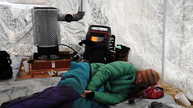 Angie Taggart rests in a musher tent at the Finger Lake checkpoint in Alaska during the Iditarod Trail Sled Dog Race on Monday, March 4, 2013. (AP Photo/The Anchorage Daily News, Bill Roth)