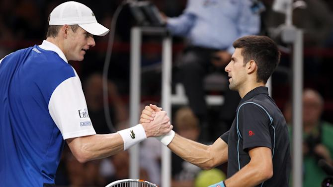 Novak Djokovic of Serbia, right, greets John Isner of the USA after their round of eight match, at the Paris Masters tennis at Bercy Arena in Paris, France, Thursday, Oct. 31, 2013. Djokovic won the match 7-6, 6-1, 6-2.(AP Photo/Francois Mori)