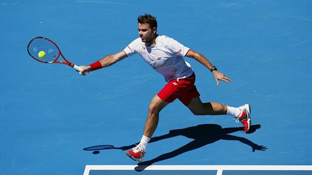 Stanislas Wawrinka of Switzerland hits a return to Andrey Golubev of Kazakhstan (Reuters)