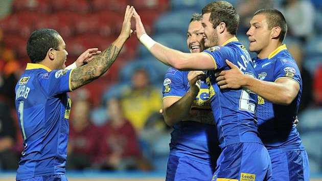 Leeds Rhinos' Zak Hardaker is congratulated on scoring his team's second try