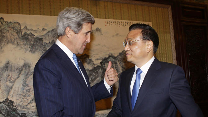 U.S. Secretary of State John Kerry, left, gestures while shaking hands with China's Premier Li Keqiang during a meeting at the Zhongnanhai compound in Beijing Saturday, April 13, 2013. The question of how Washington can persuade Beijing to exert real pressure on North Korean leader Kim Jong Un's unpredictable regime is front and center as Kerry meets Saturday with Chinese leaders in Beijing. (AP Photo/Jason Lee, Pool)