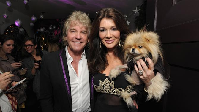 """IMAGE DISTRIBUTED FOR BRAVO - Ken Todd, left, Lisa Vanderpump, and their dog Giggy attend the premiere party for """"Vanderpump Rules"""" at SUR restaurant, on Monday, Dec. 10, 2012 in Los Angeles. The show premieres on January 7, 2013 on Bravo.  (Photo by John Shearer/Invision for Bravo/ AP Images)"""
