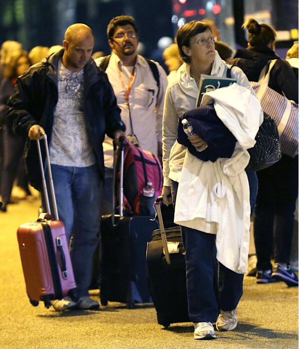 Passengers from the disabled Carnival Triumph cruise ship arrive by bus at the Hilton Riverside Hotel in New Orleans, Friday, Feb. 15, 2013. The ship had been idled for nearly a week in the Gulf of Me