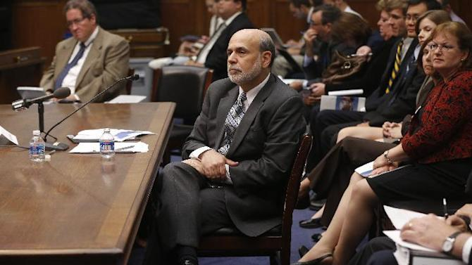 FILE - In this Wednesday, July 17, 2013, file photo, chairman of the Federal Reserve Ben Bernanke testifies in Washington. The Federal Reserve appears on track to slow its bond purchases by the end of this year if the economy continues to improve. But it remains divided over the exact timing of the move. That's the message from the minutes of the Fed's July 30-31 meeting released Wednesday, Aug. 21, 2013. (AP Photo/Charles Dharapak)