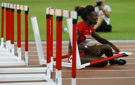 Americans Harper-Nelson, Harrison out of hurdles