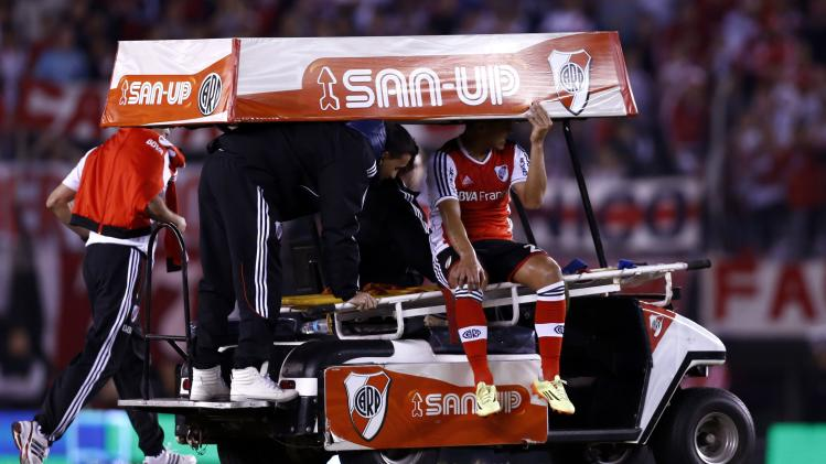 River Plate's Teofilo Gutierrez is taken off the field after he was injured when he collided with a Velez Sarsfield player during their Argentine first division soccer match in Buenos Aires