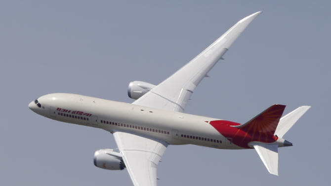 An Air India Boeing 787 Dreamliner performs its demonstration flight during the first day of the 50th Paris Air Show at Le Bourget airport, north of Paris, Monday, June 17, 2013. (AP Photo/Francois Mori)