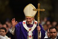 "Pope Benedict XVI waves as he leaves after celebrating Mass on February 13, 2013 at St Peter's basilica at the Vatican. Pope Benedict XVI urged an end to ""religious hypocrisy"" and ""rivalry"" in the Catholic Church as he donned his papal mitre for the last time"