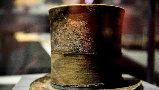 "FILE - In this March 17, 2015 file photo, President Abraham Lincoln's top hat from the night of his assassination is on display at a new exhibit entitled ""Silent Witnesses: Artifacts of the Lincoln Assassination"" at the Ford's Center for Education and Leadership across the street from the historic Ford's Theatre where President Abraham Lincoln was killed, in Washington. The exhibit is open to the public until May 25, and coincides with the 150th anniversary of the Lincoln assassination on April 14. (AP Photo/Andrew Harnik, File)"