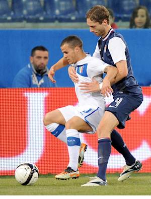 US defender Clarence Goodson, right, and Italy forward Sebastian Giovinco vie for the ball during a friendly soccer match between Italy and USA, at the Genoa Luigi Ferraris stadium, Italy, Wednesday, Feb. 29, 2012. USA won 1-0. (AP Photo/Tanopress)