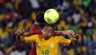 <p>South Africa midfielder Thuso Phala heads the ball during the South Africa vs Morocco Africa Cup of Nations 2013 group A football match at Moses Mahiba Stadium in Durban on January 27, 2013. South Africa came from behind twice to draw 2-2 with Morocco Sunday and top Group A in the Africa Cup of Nations.</p>
