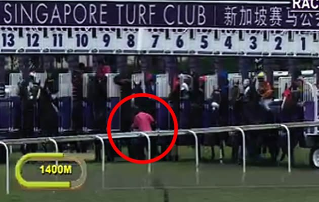 "Singapore Turf Club (STC) said in a statement on Wednesday that a man, who looked like he was almost trampled over by horses in a race video, is ""unhurt"". (Singapore Turf Club video screengrab)"